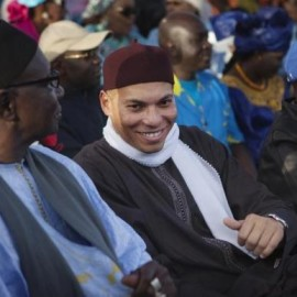Karim Wade, son of Senegal's former president Abdoulaye Wade, attends a rally by his father's political party PDS in Dakar
